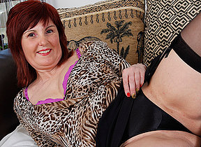 Morose mature housewife plays with her favorite toys