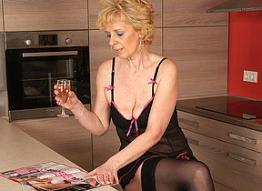 This blonde mature slut loves to masturbate in her kitchen