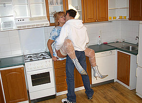 Horny missis fucking in her kitchen