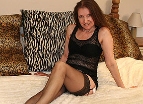Horny mature hussy playing with her toy