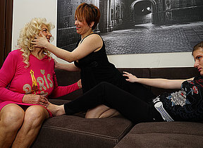 Three horny old and young lesbians make out on the sofa