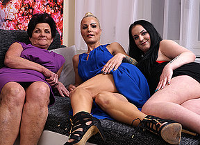 Three old and young lesbians make out on the sofa
