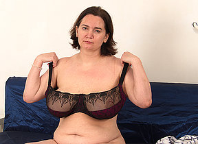 Mature housewife shows off big saggy tits and fucks her young boyfriend