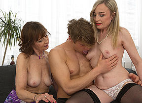 Two mature housewives share their toyboys cock
