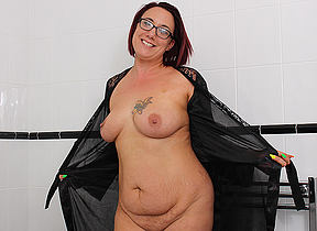 British housewife playing with her shaved pussy in the bathtub